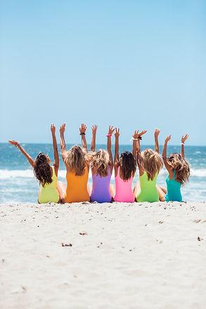 back-view-photo-of-six-girls-wearing-swi