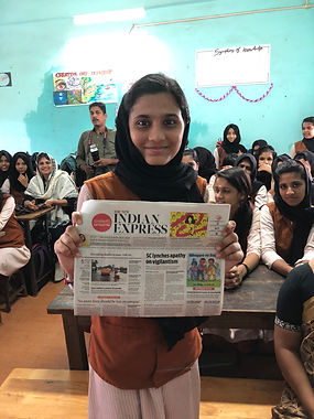 girl holding a newspaper