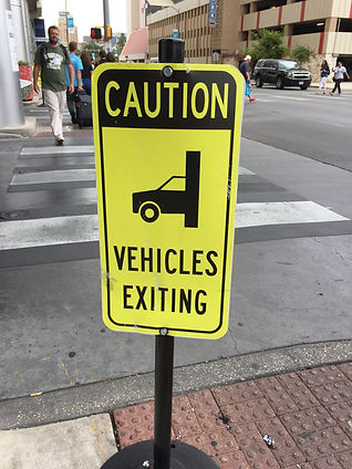caution: vehicles exiting sign