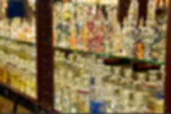 scent-and-perfume-jars-on-a-shop-shelf-h