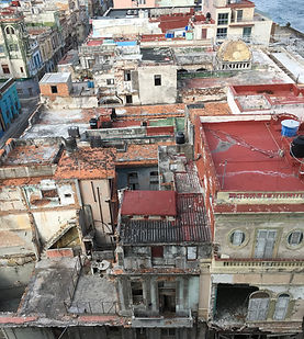 """from our """"hotel"""" room on the Malecón... people livig in every building along the coast"""