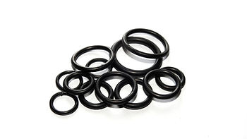 assortment of black rubber washers on a