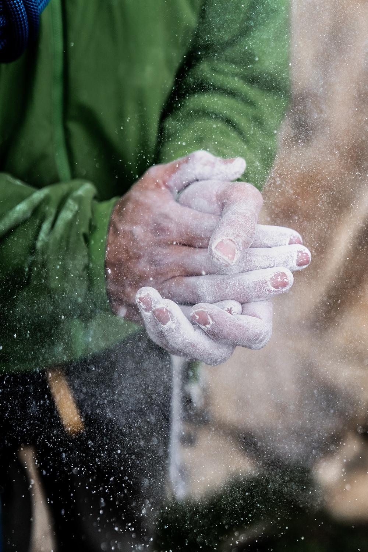 man applying climbing chalk