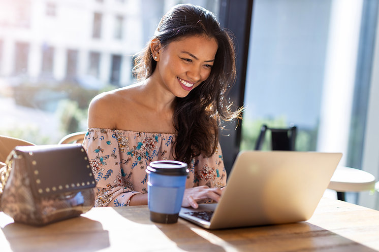 Beautiful Filipino woman using laptop at cafe.jpeg