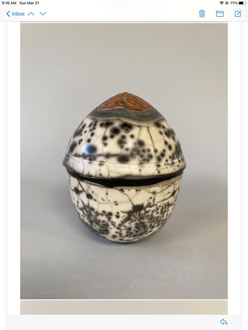 Egg-shaped naked raku