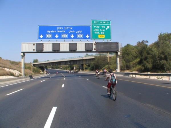 Biking down the empty Ayalon highway through Tel Aviv.