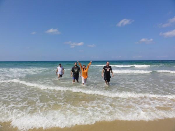 Leah rejoicing as she exits the sea.