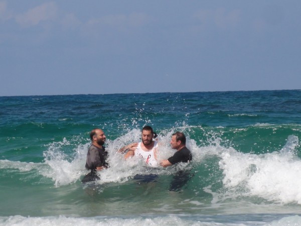 Barak (with me, Moti and Uziel) just before we all got immersed by a wave!