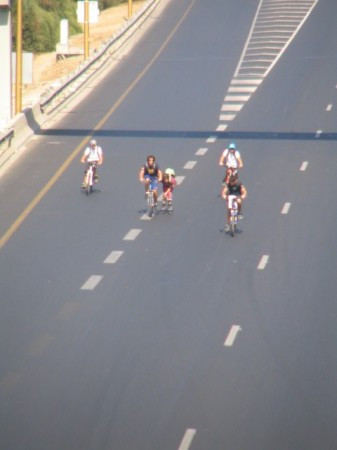 Kids bike down the highway