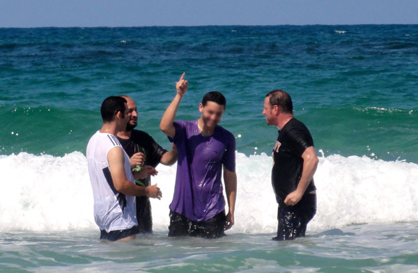 Yosi celebrating after being immersed.