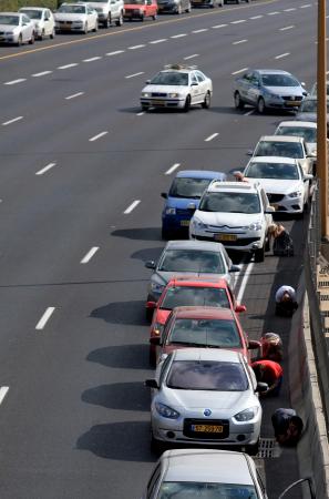 Photo: IDF Israelis take cover on highway as Hamas shoots Rockets at civilians.