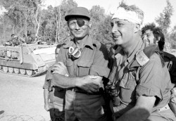 Israeli Major General in the reserves Ariel Sharon (R), his head bandaged after an injury, stands with Moshe Dayan (L) on the western side of the Suez Canal in this October 1973 file photo released by Israels Defence Ministry. —Reuters