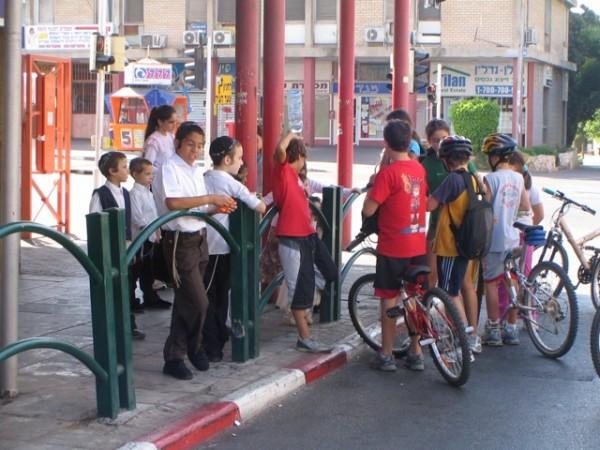 Biking secular kids talk to Orthodox children who were forbidden to bike.