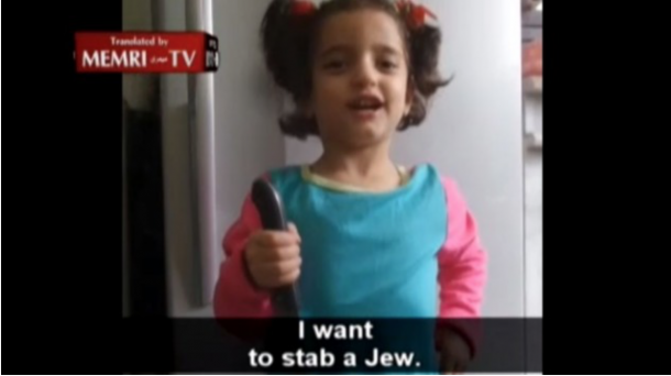An Arab girl is being trained by her father to kill Jews. This photo was taken on October 16, 2015.
