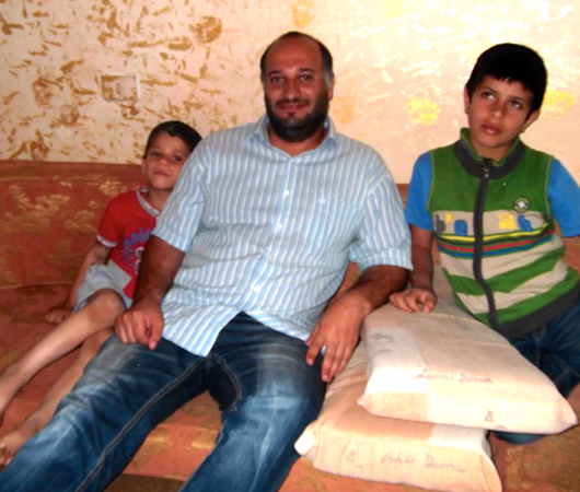 Moti with two war-orphans form Syria.