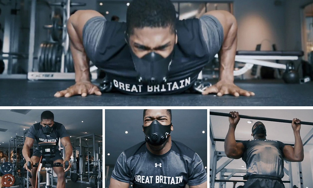 British heavyweight champion performing exercise whilst wearing a training mask