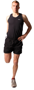 a man performing a flexibility exercise that stretches his quadriceps muscles