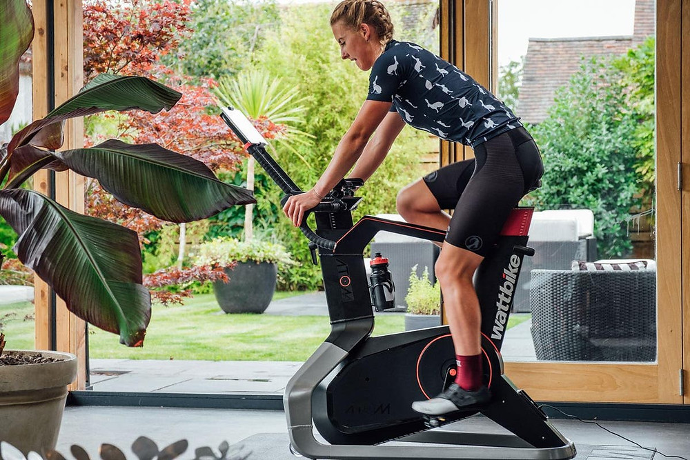 a woman cycling on an indoor bike as part of an active lifestyle