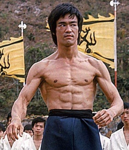 Bruce Lee tensing his super-ripped six-pack
