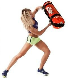 woman holding a piece of exercise equipment - power bag