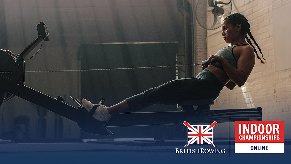 An image of a woman on rowing machine in a gym. She is rowing a marathon.