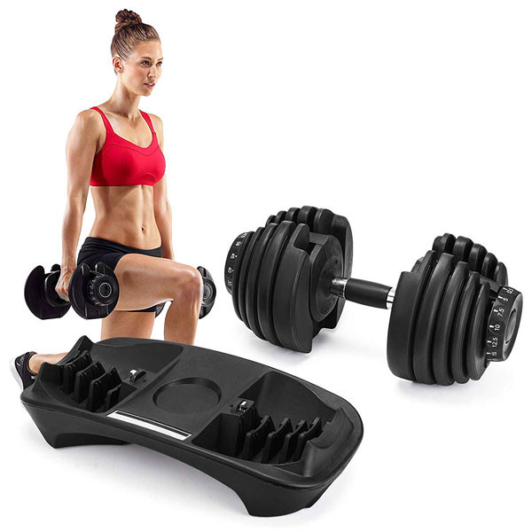 A woman completing a dumbbell leg workout. She is using a pair of adjustable station dumbbells.