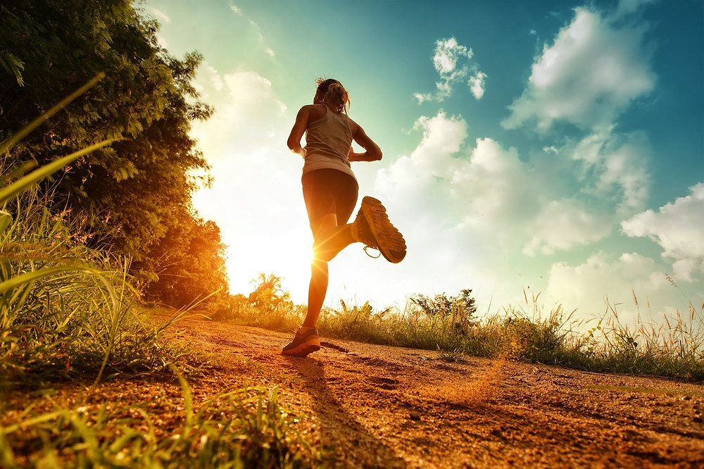 a woman running outside in the sun