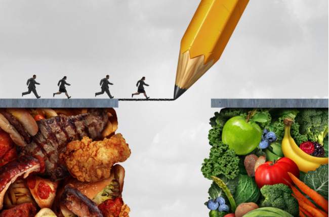 a cartoon image showing people trying to transition from a omnivorous diet to vegetarian diet