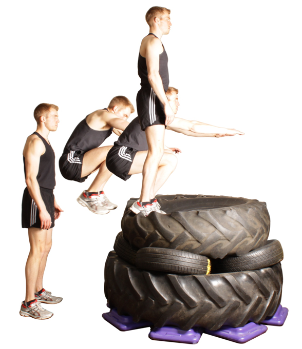 an image of man performing a plyometric jump onto a a stack of tyres.