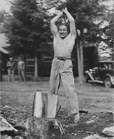 heavy weight boxer Max Baer chopping wood