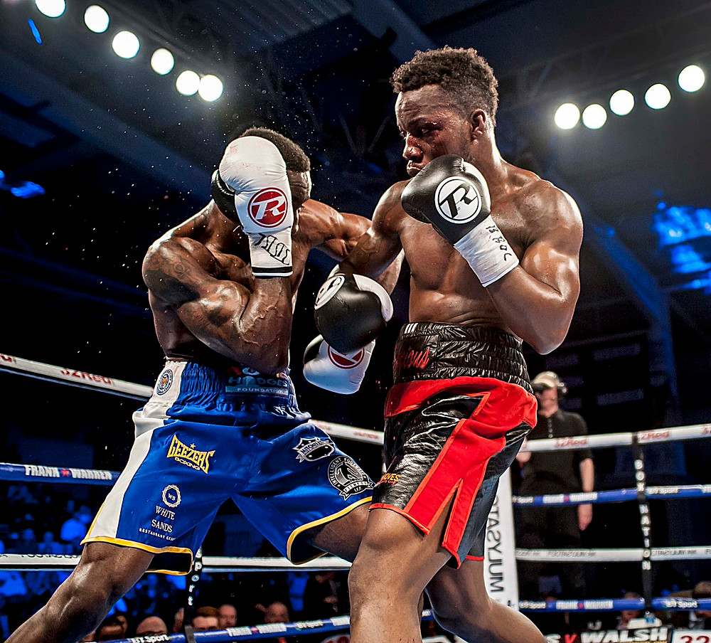 Two boxers competing in a world title fight. Both are wearing 16oz boxing gloves.