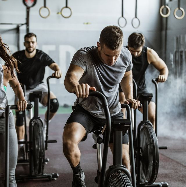 a group of people exercising on indoor bikes