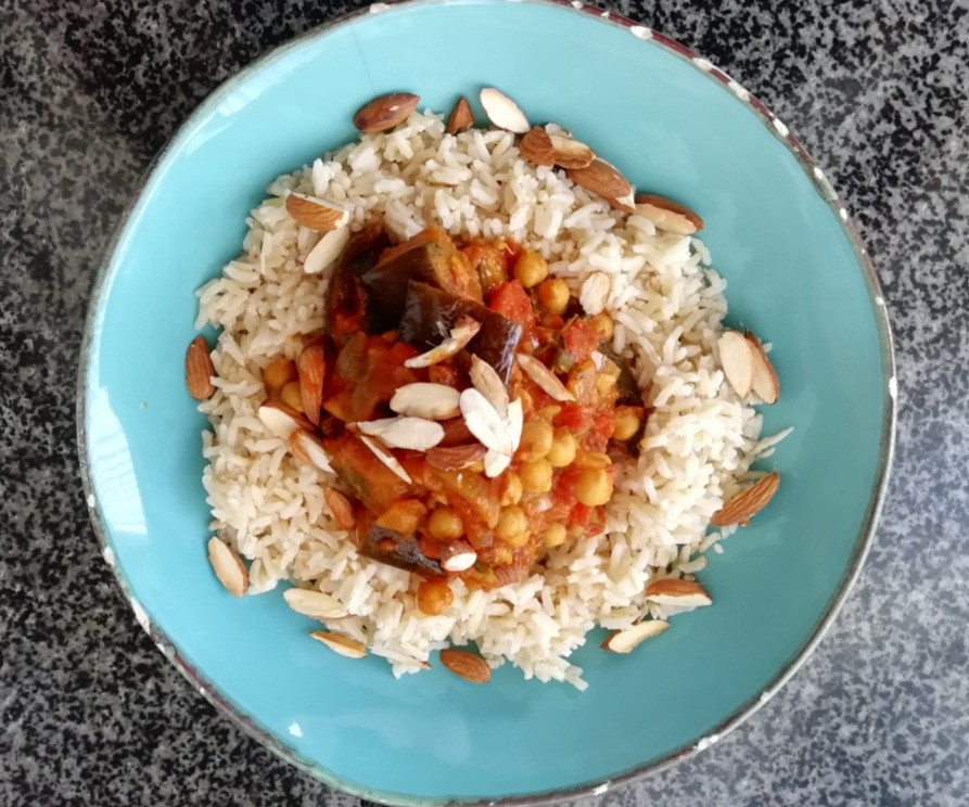 a super healthy slow roasted aubergine and chick pea curry with brown basmati rice and roasted almonds