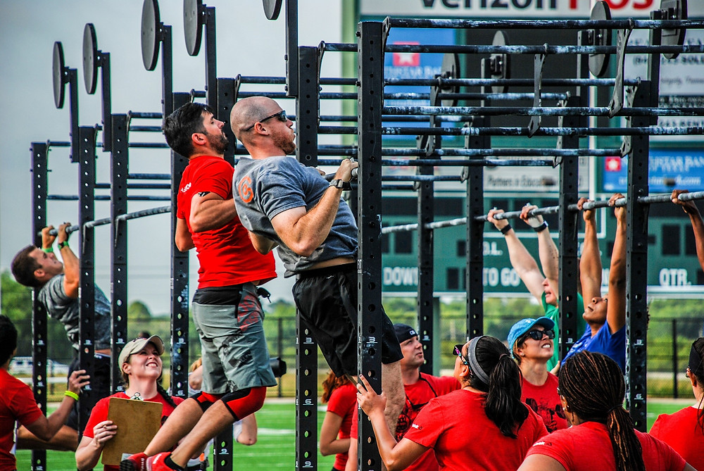 a group of exercise enthusiasts completing a CrossFit training session