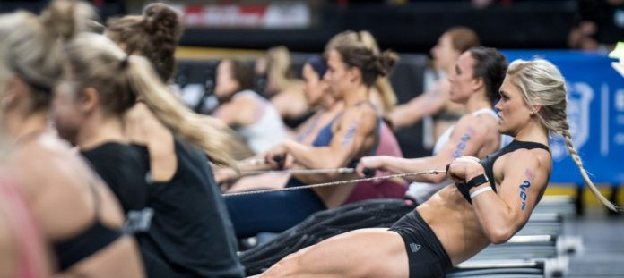 A picture of CrossFit athletes competing in the row marathon.