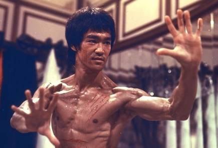 Bruce Lee preparing to fight in the film Enter the Dragon