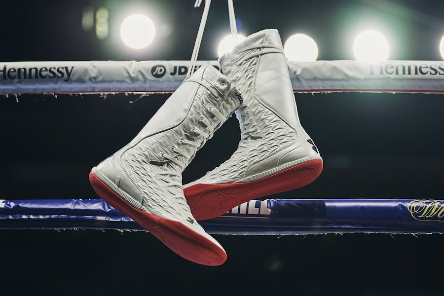 a pair of the best boxing boots hanging from the ropes of a boxing ring