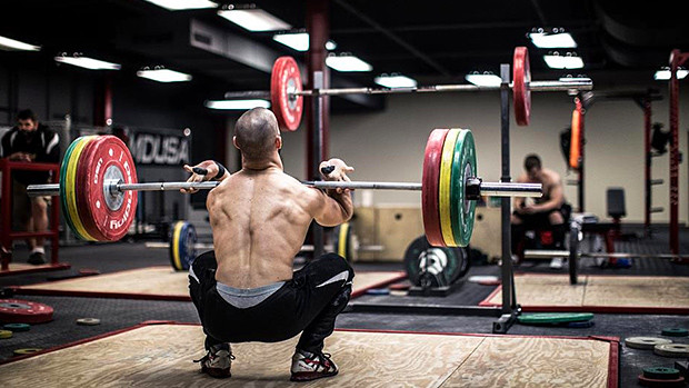 a man in the front squat position