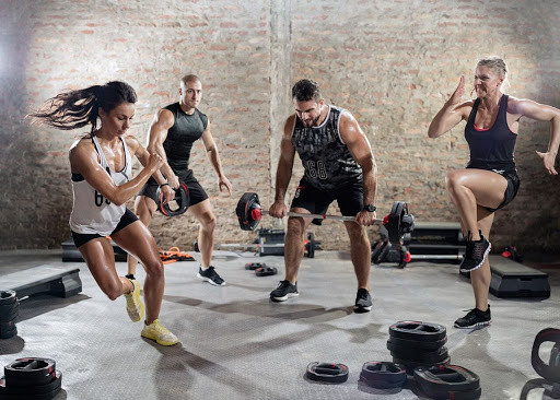 four people exercising in a circuit training session