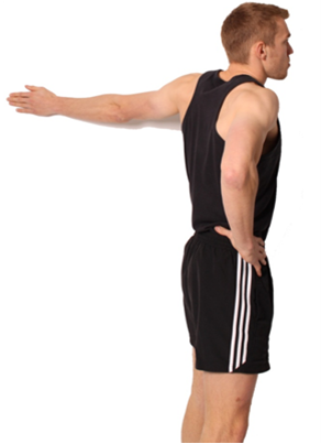 a man performing a flexibility exercise that stretches his chest and bicep muscles