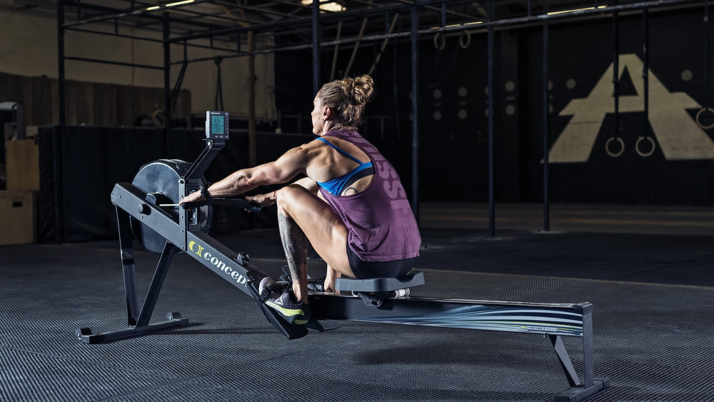 a woman on an indoor rowing machine