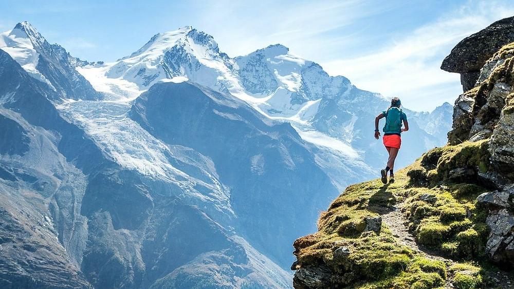a man running along a mountain pass