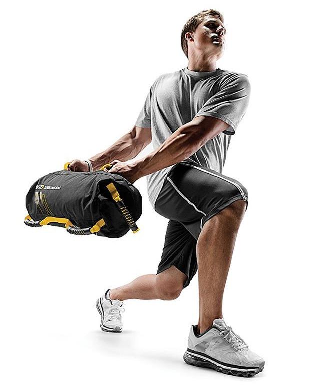 a man performing sandbag exercises. The sandbag exercise he is performing is the lung into side rotation.