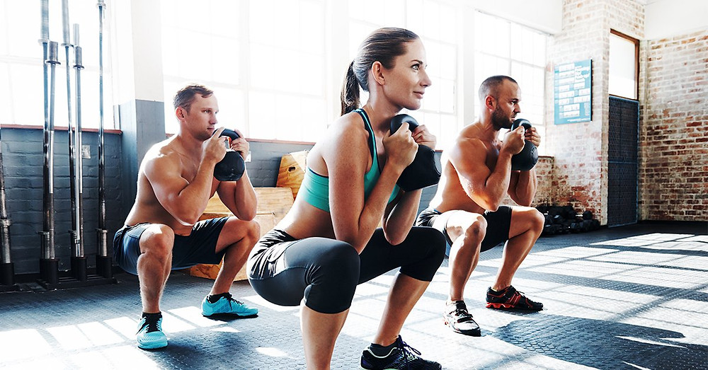A group of fitness enthusiasts are taking part in a kettle bell weight loss workout. They show the kettlebell weight loss before and after affects.
