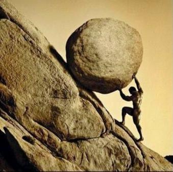 a man pushing a boulder up a steep hill