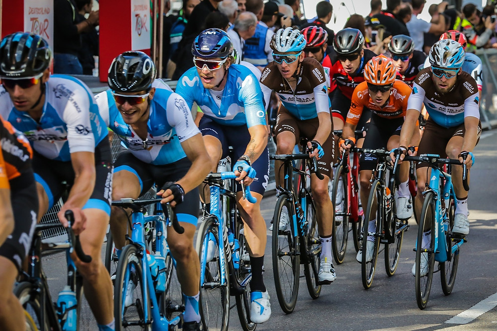 a group of male cyclists racing each other