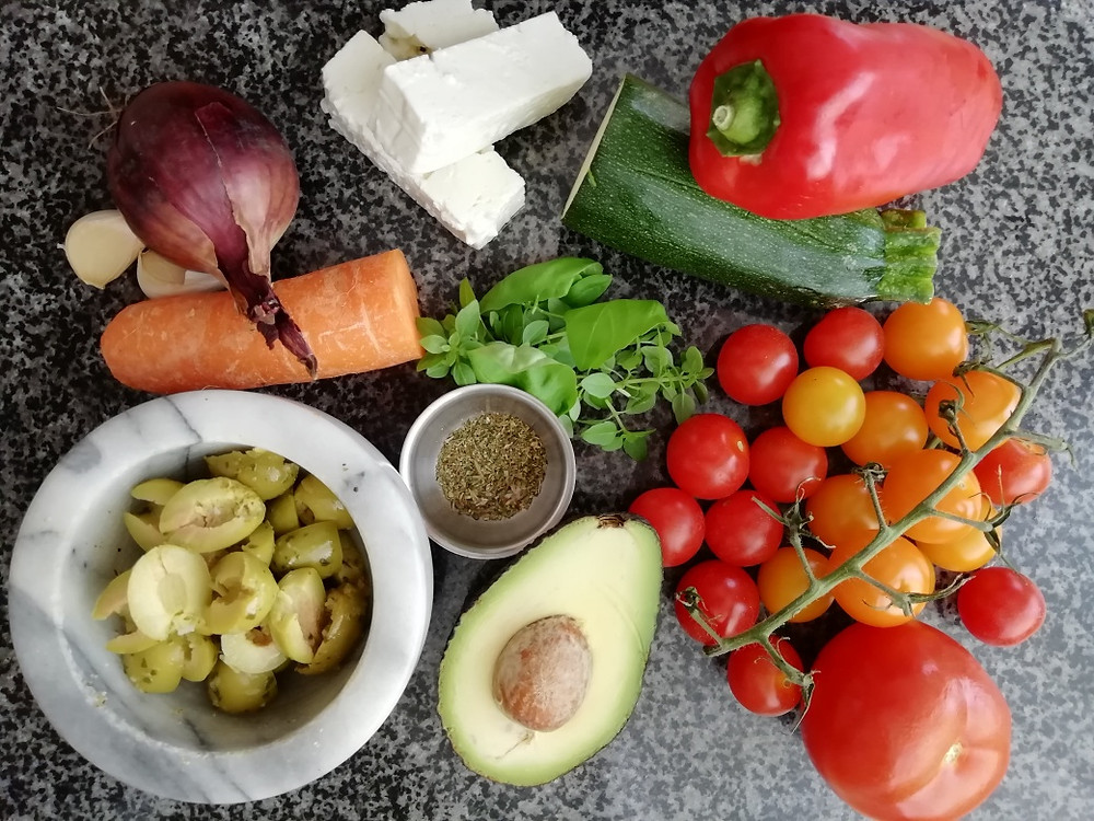 an assortment of fresh ingredients for the Mediterranean pasta salad