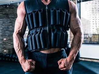 man in a gym wearing a weighted vest