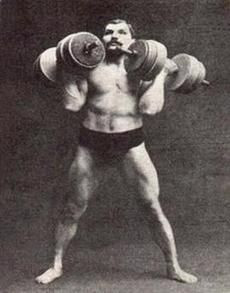 strong man with two heavy dumbbells