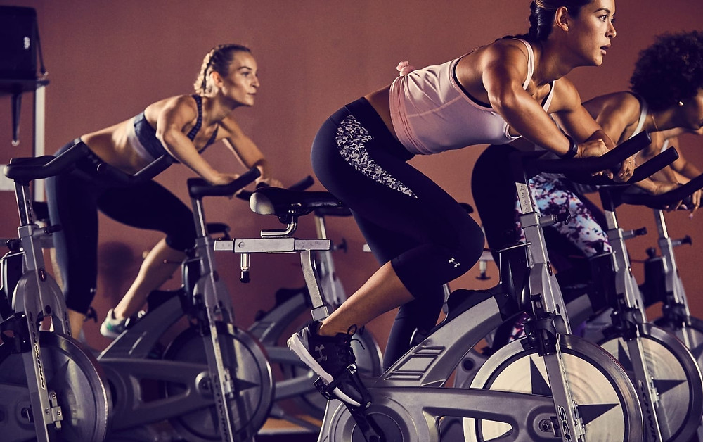 woman exercising on indoor spinning bikes